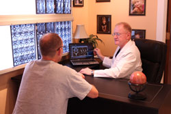 patient consultation about back pain conditions and chiropractic relief options